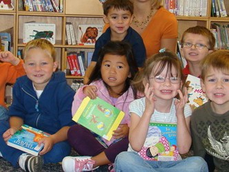 Kids make a variety of expressions while holding books