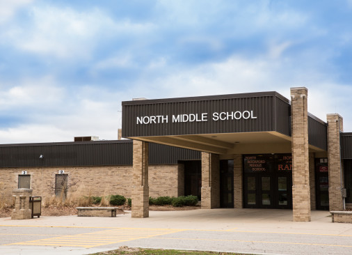 The square tan and dark brown North Middle school building