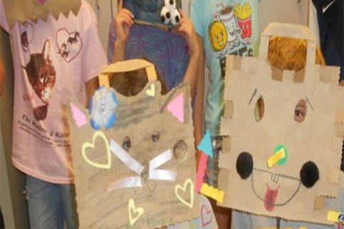 Kids wearing kitty mask made out of paper bags