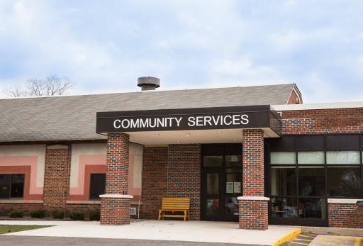 The dark multiple color brick Rockford Community Service building