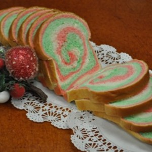Slice portions of bread with Christmas colors swirling inside